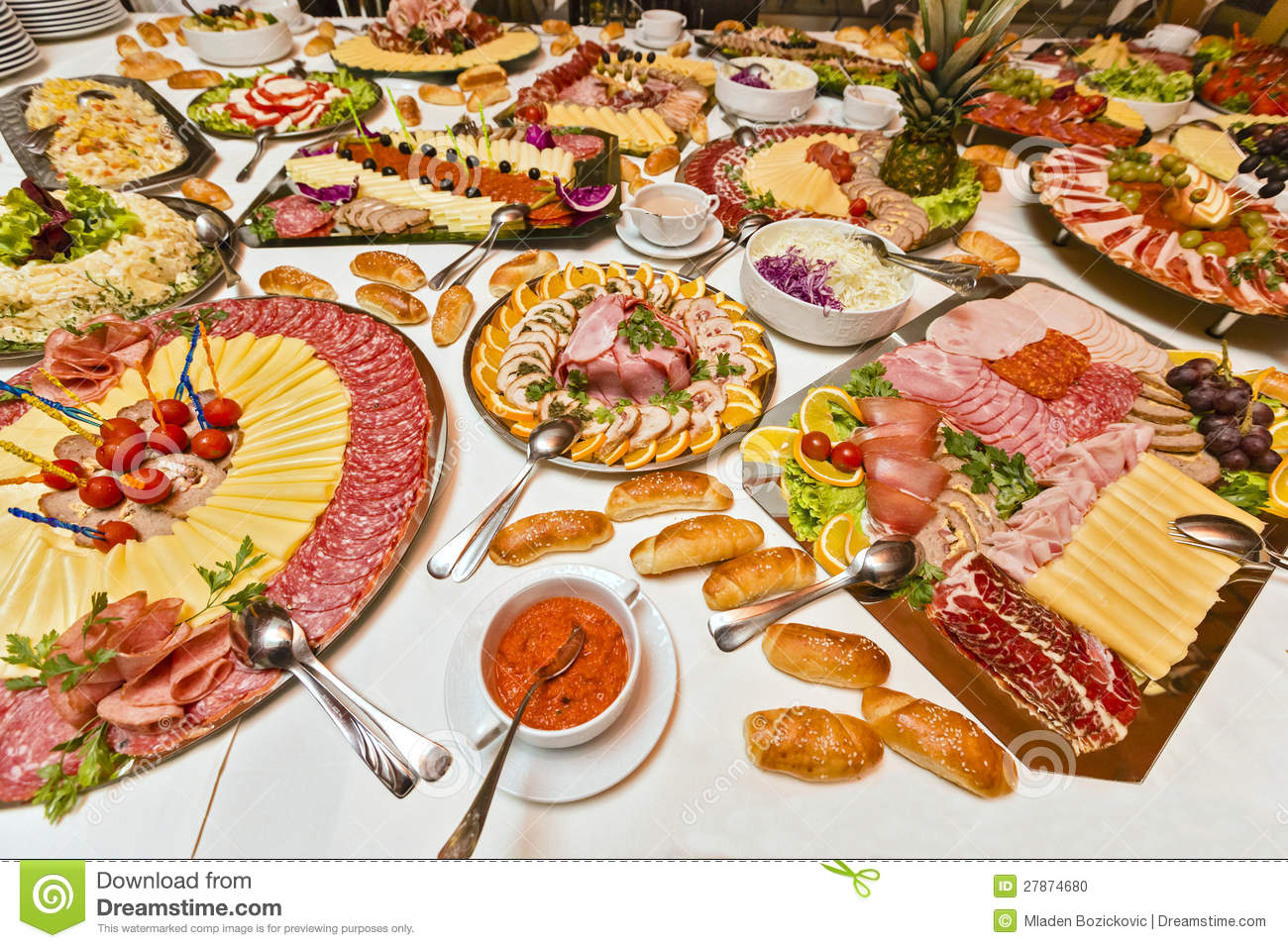 Table filled with numerous types of tasty, catering food.