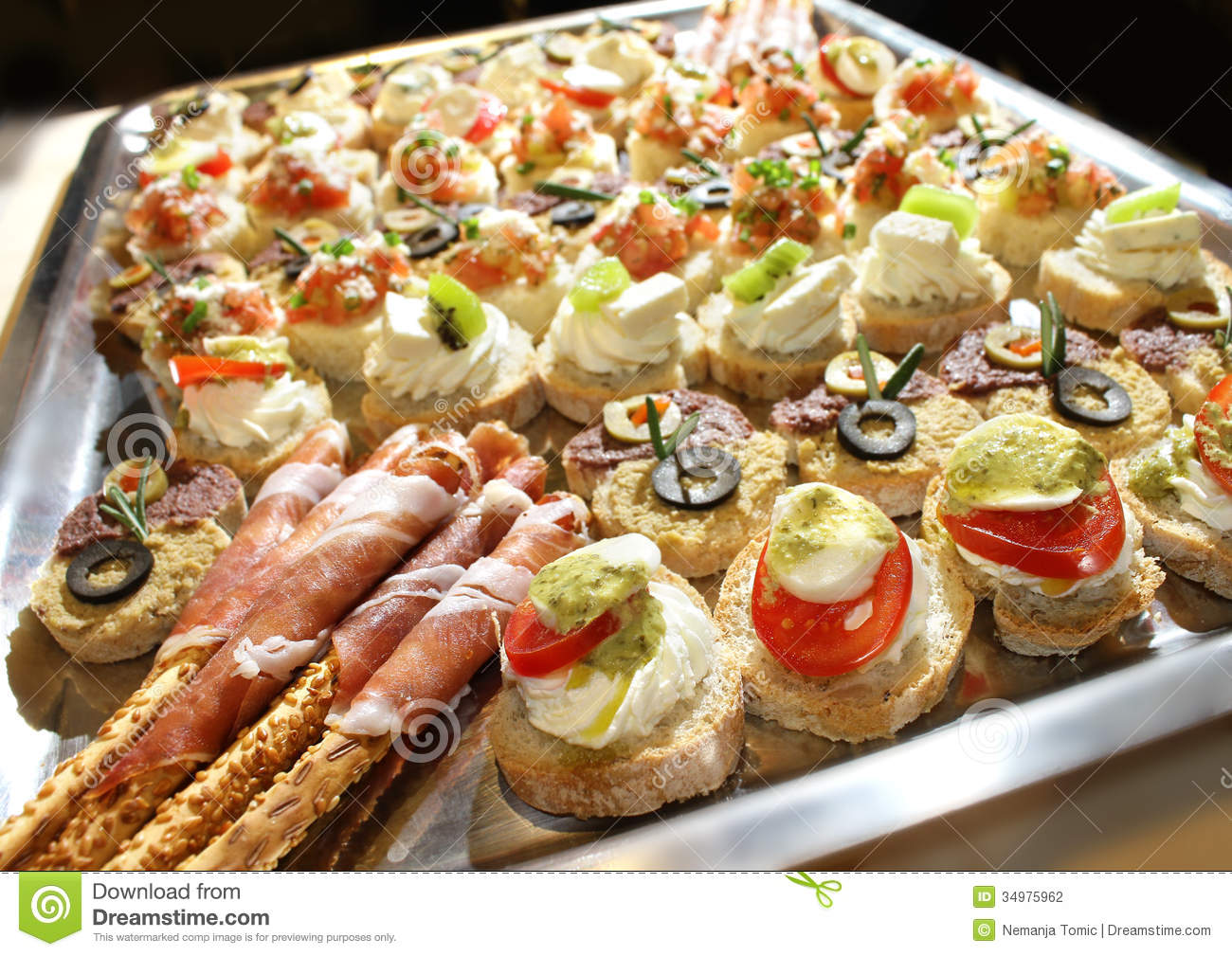 Variety of finger food on catering event. Shallow focus.