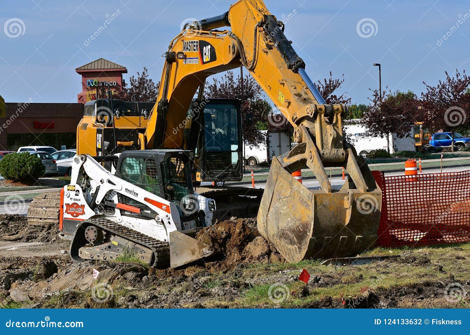 Caterpillar Excavator And Bobcat Skid Steer Editorial