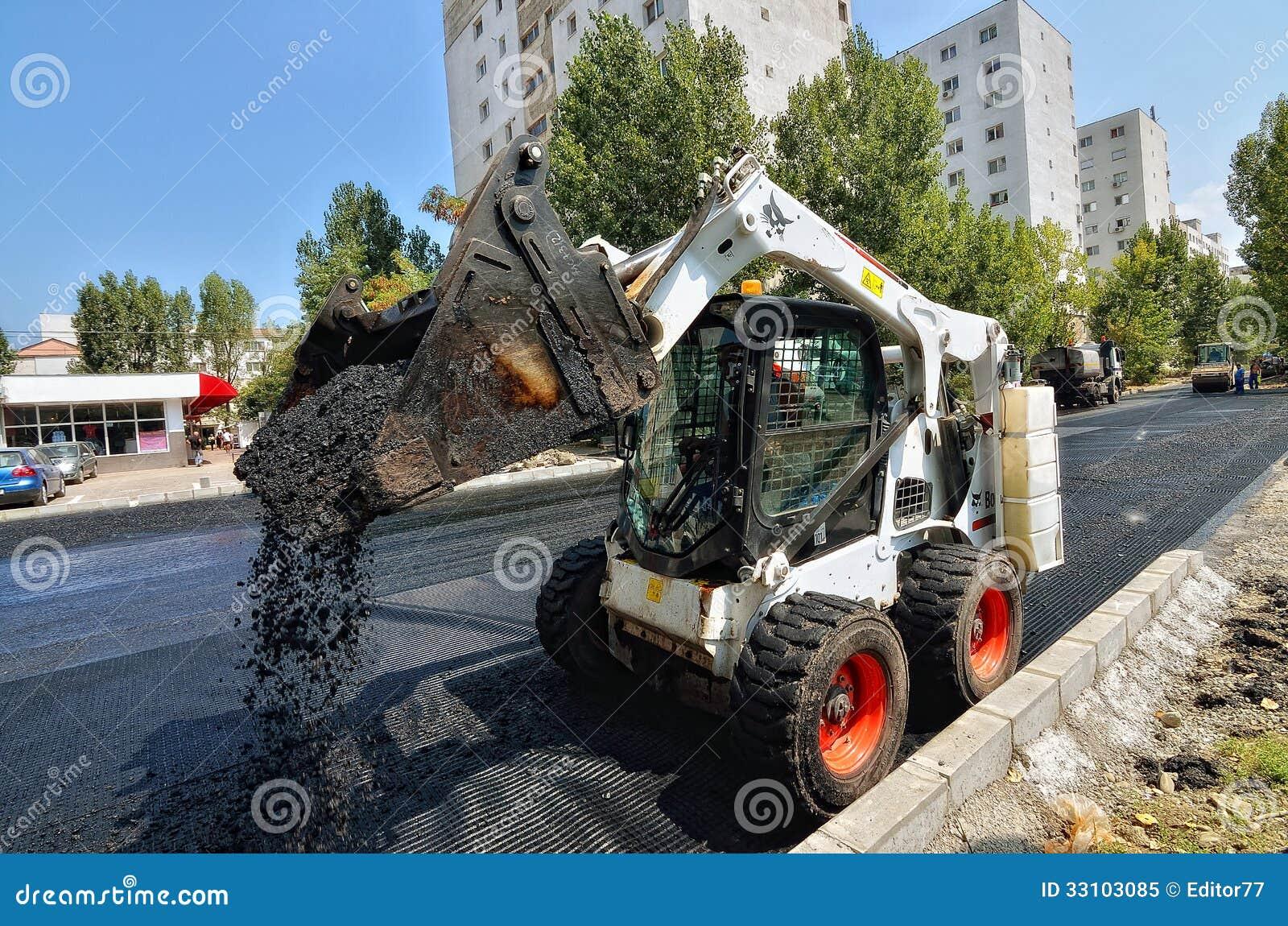 Skid Steer Prices >> Caterpillar Skid Steer Loader At Work Editorial Image - Image: 33103085