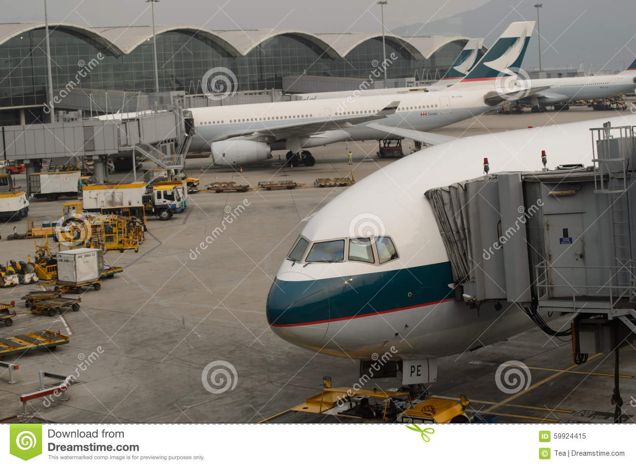 Cathay pacific aircraft near boarding bridge editorial image image 59924415 - Cathay pacific head office ...