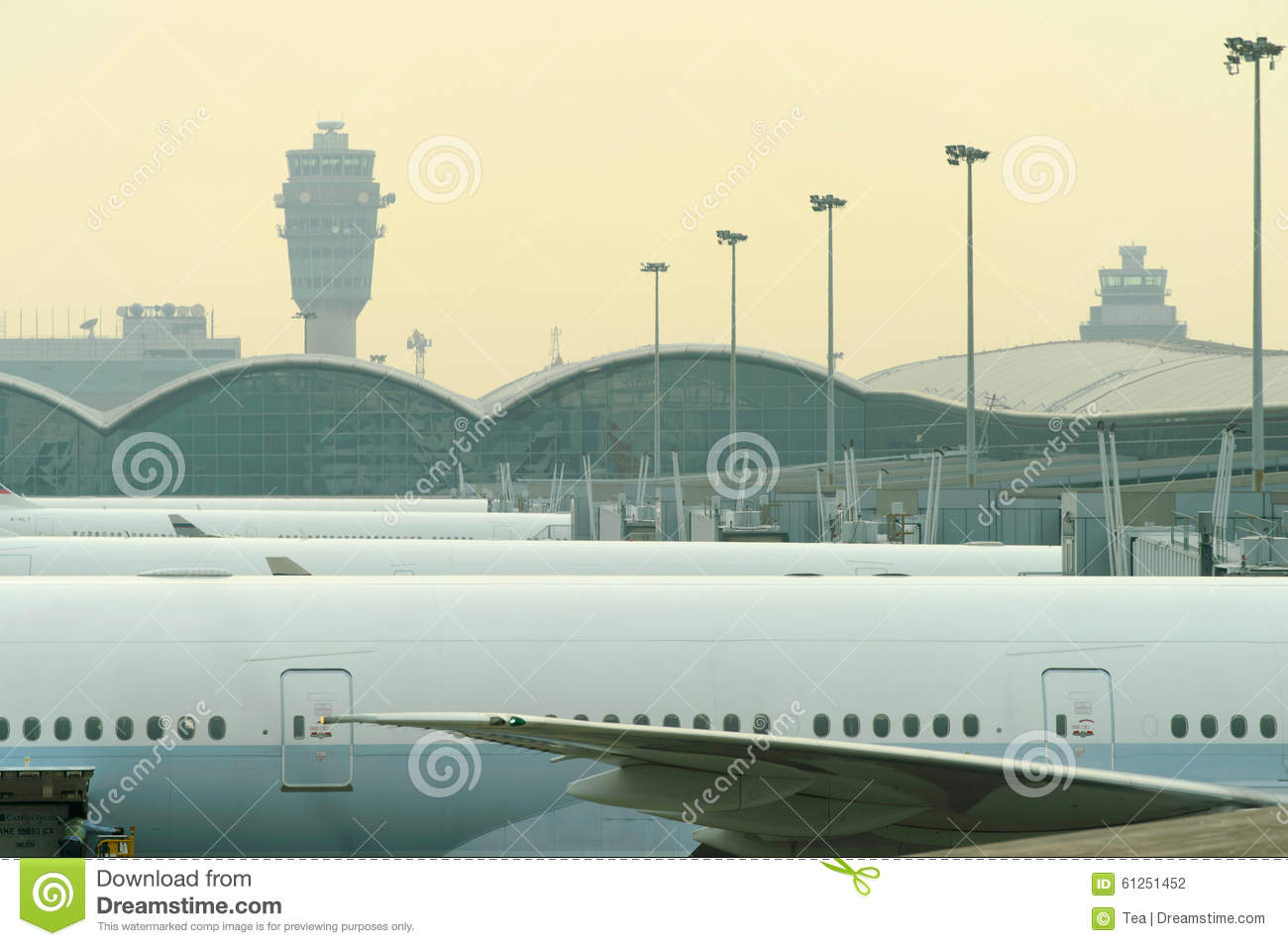 Cathay pacific aircraft near boarding bridge editorial photography image 61251452 - Cathay pacific head office ...