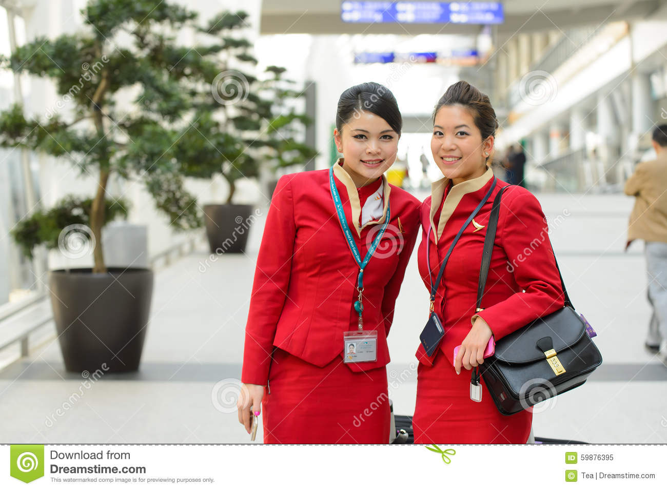 Cathay pacific crew members posing in airport editorial image image 59876395 - Cathay pacific head office ...