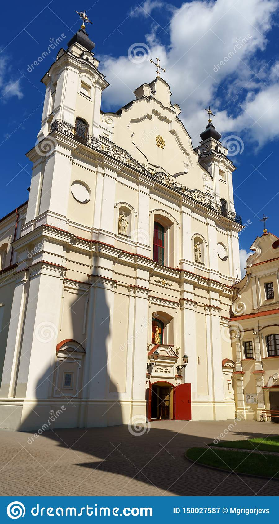 Cathedral Basilica of the Assumption of the Blessed Virgin Mary with the shadow of its Bell tower, Pinsk, Belarus, June 21, 2017