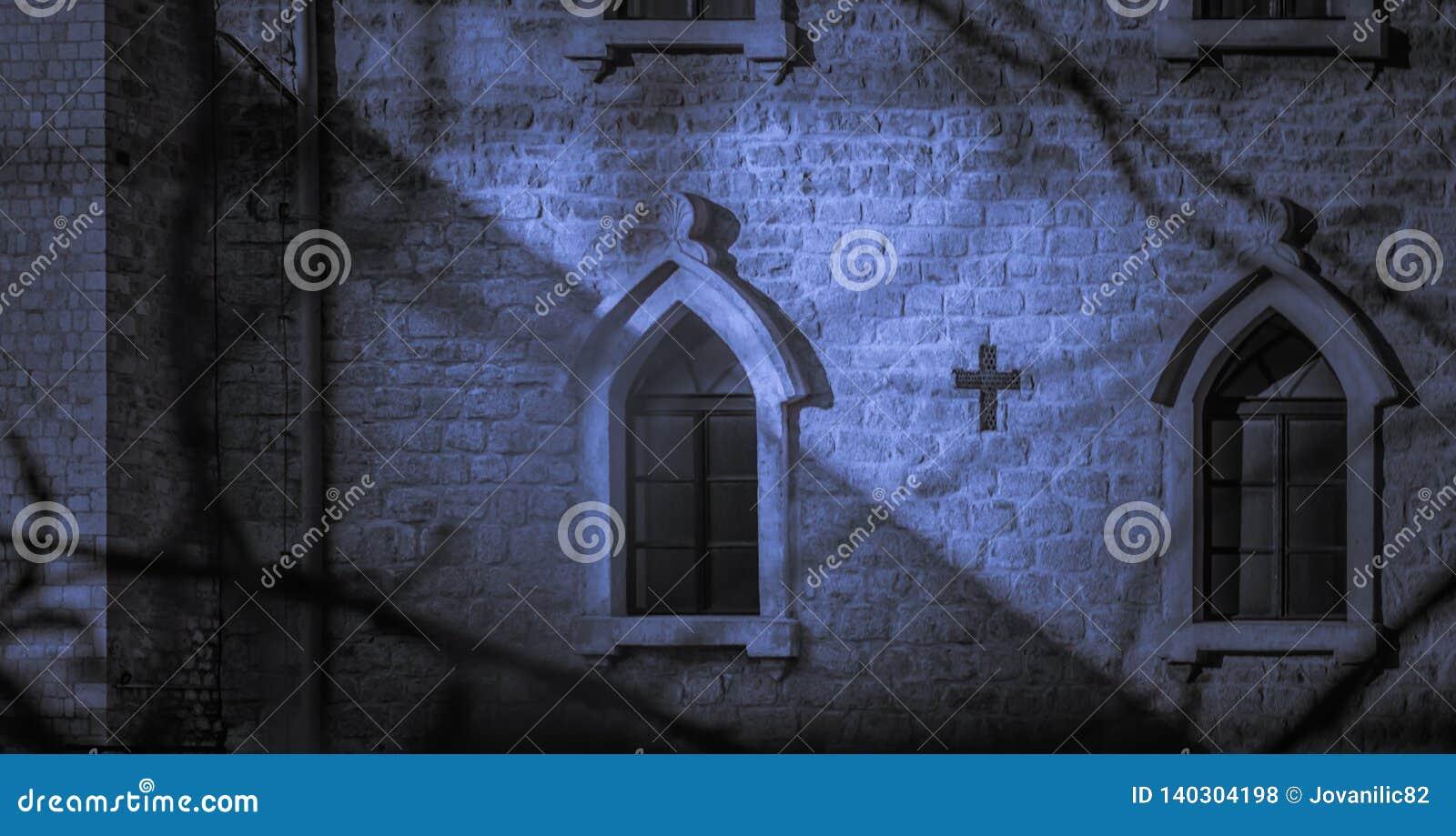 Catholic church at night, moonlight shadows