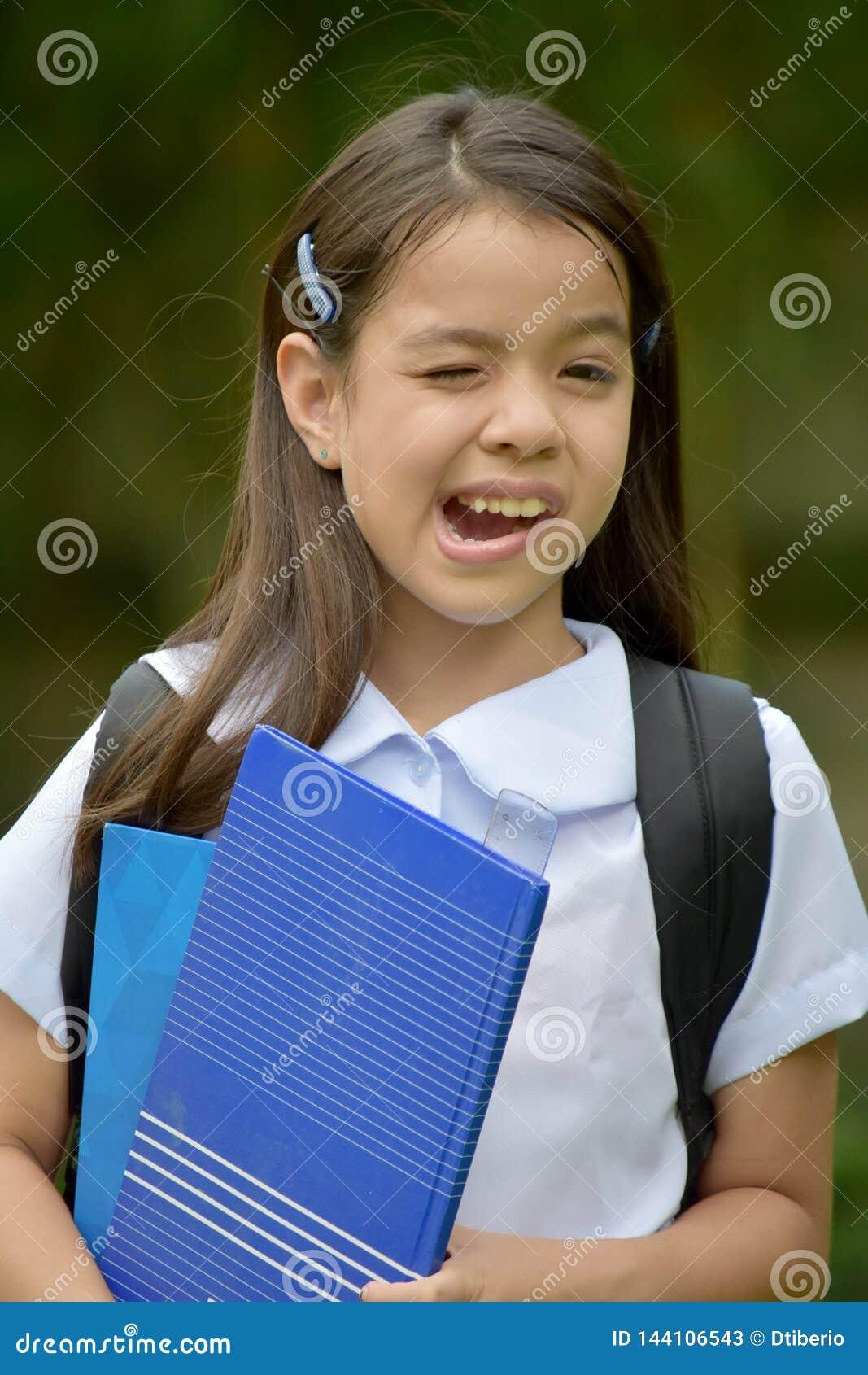 Catholic Minority Child Girl Student Making Funny Faces With