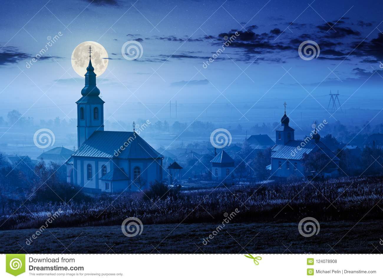 Catholic and orthodox churches at foggy night