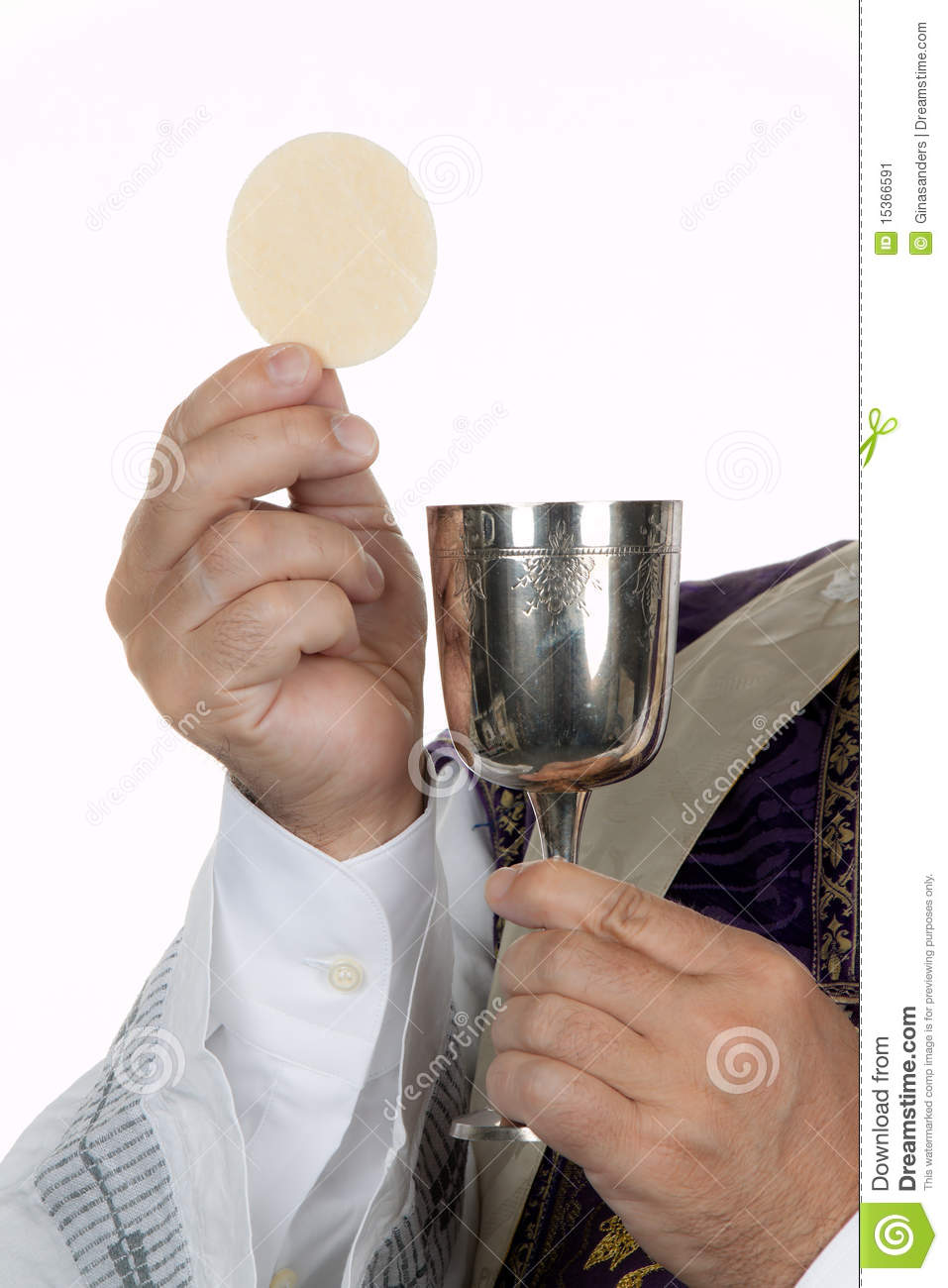 Catholic priest with chalice and host at Communion