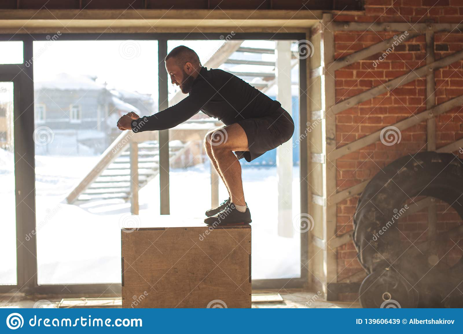 Caucasian Athletic Man Performing Plyo Box Jump Exercise