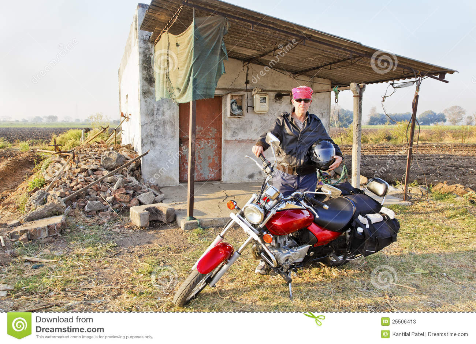 Caucasian Biker outside country shack