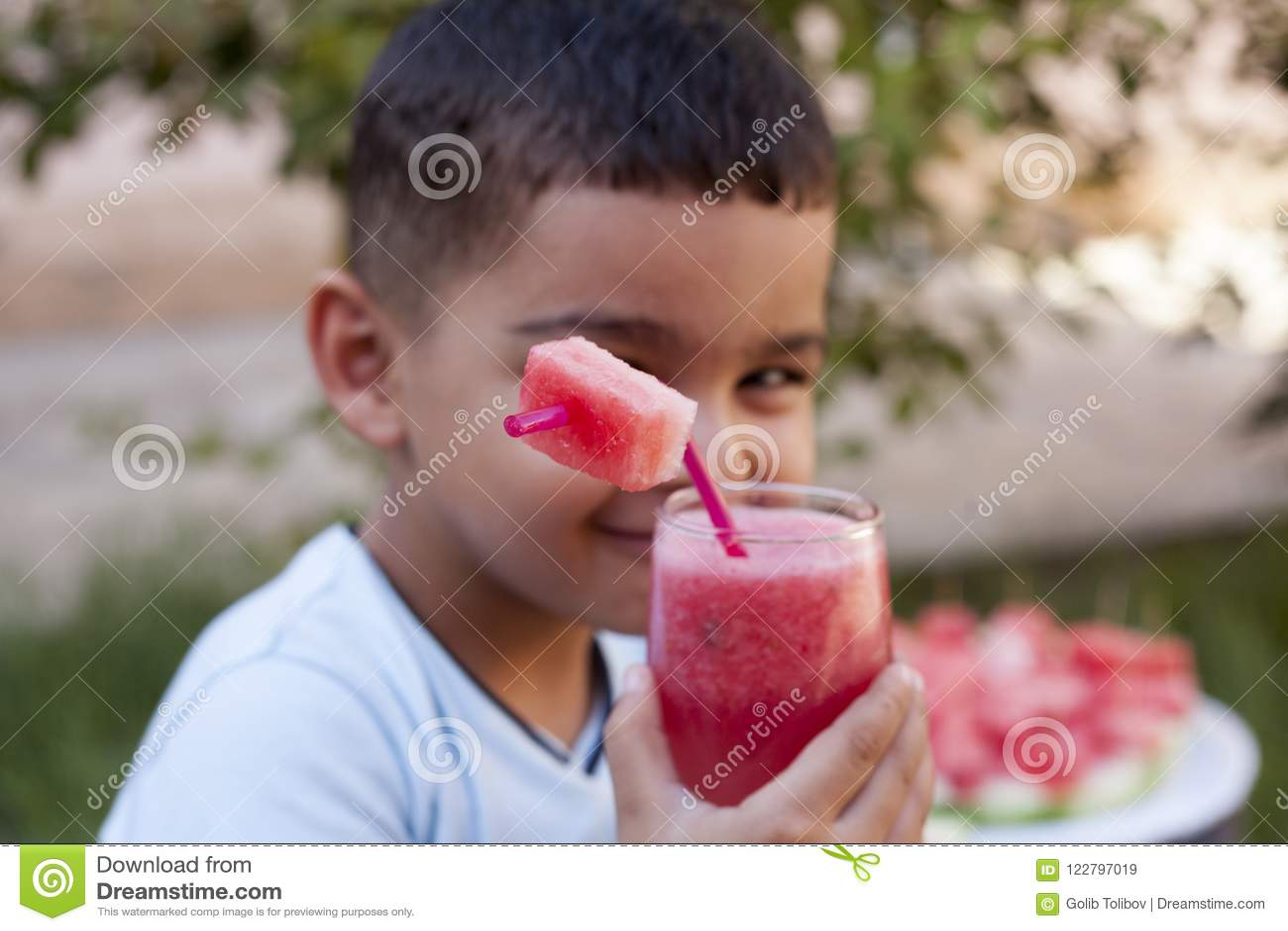 Caucasian boy with watermelon juice