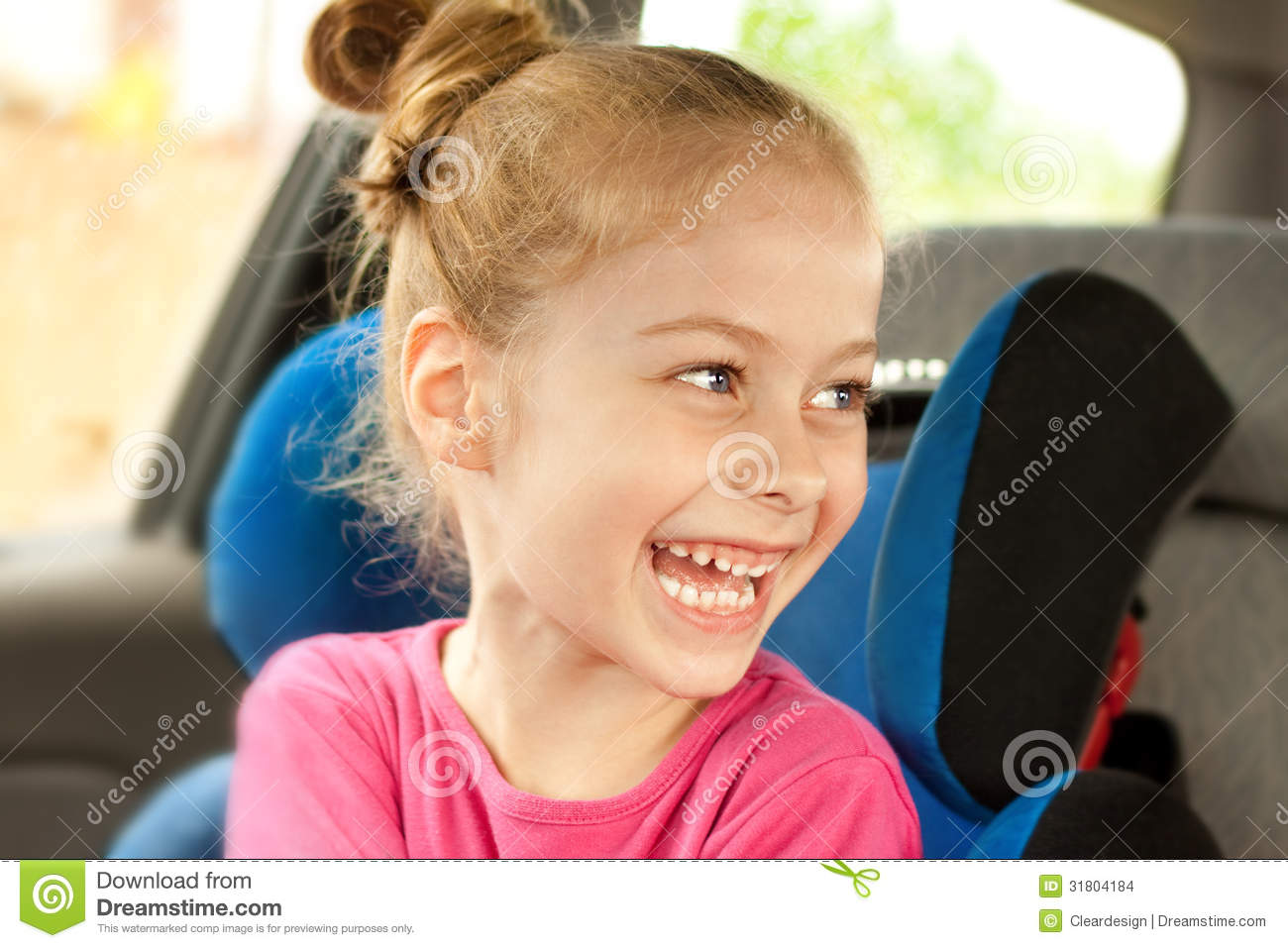 Caucasian Child Girl Laughing While Traveling In A Car Seat