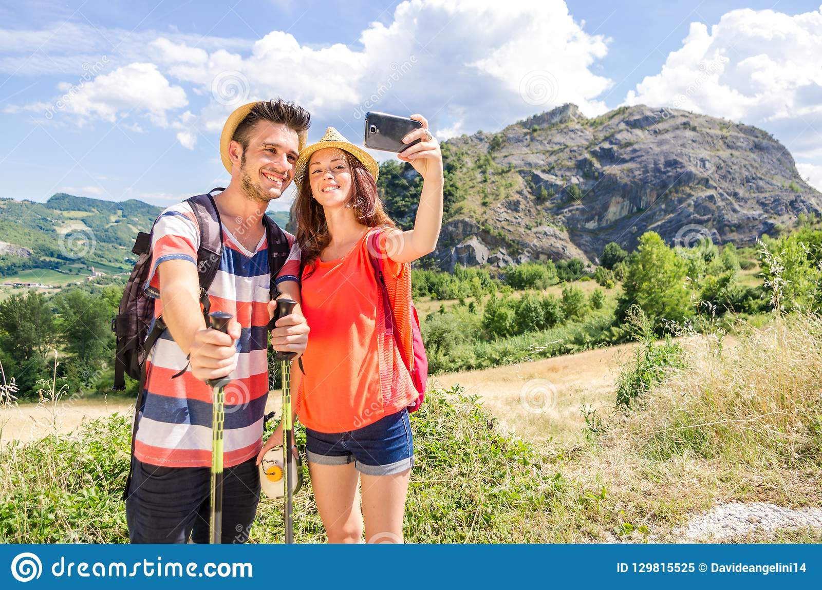 Loving couple of hikers taking a selfie on vacation