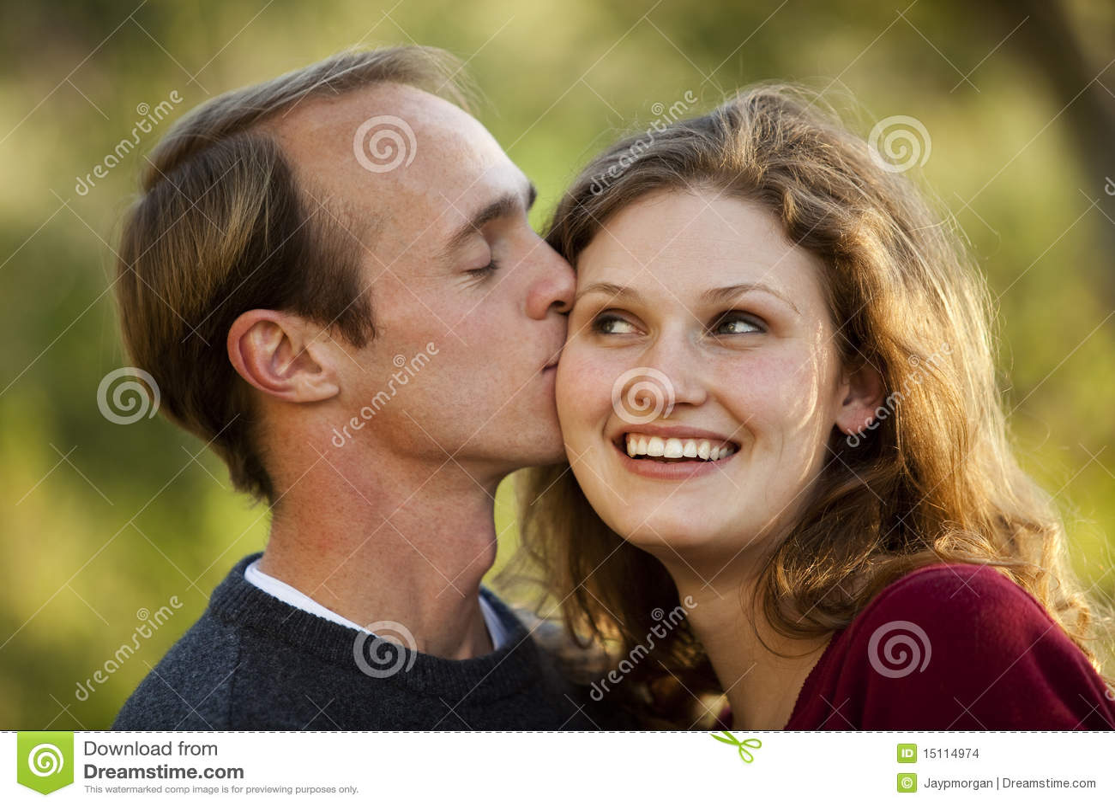 Caucasian couple in love man kissing woman