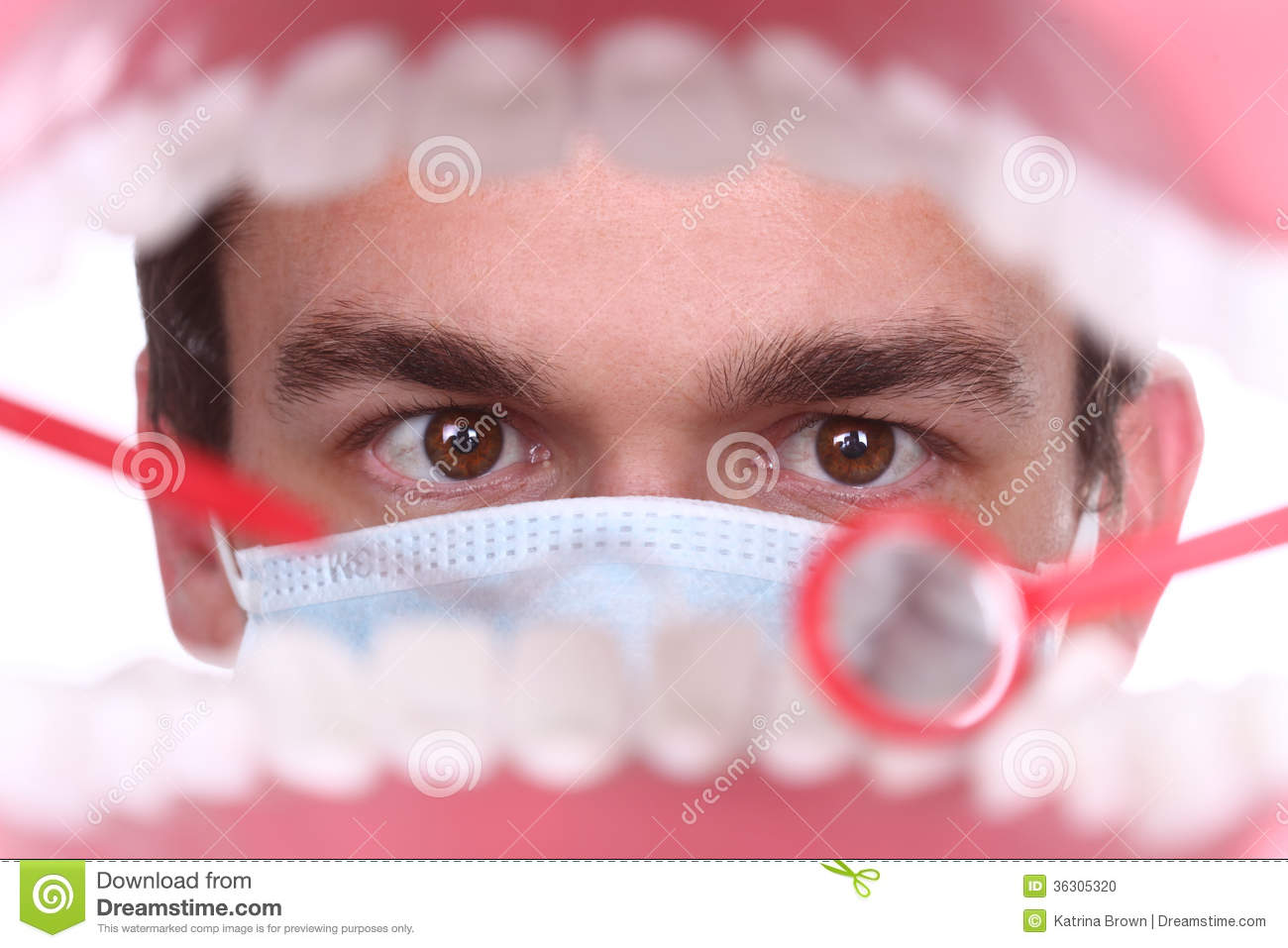 Caucasian Dentist Working Inside A Patient Mouth Stock