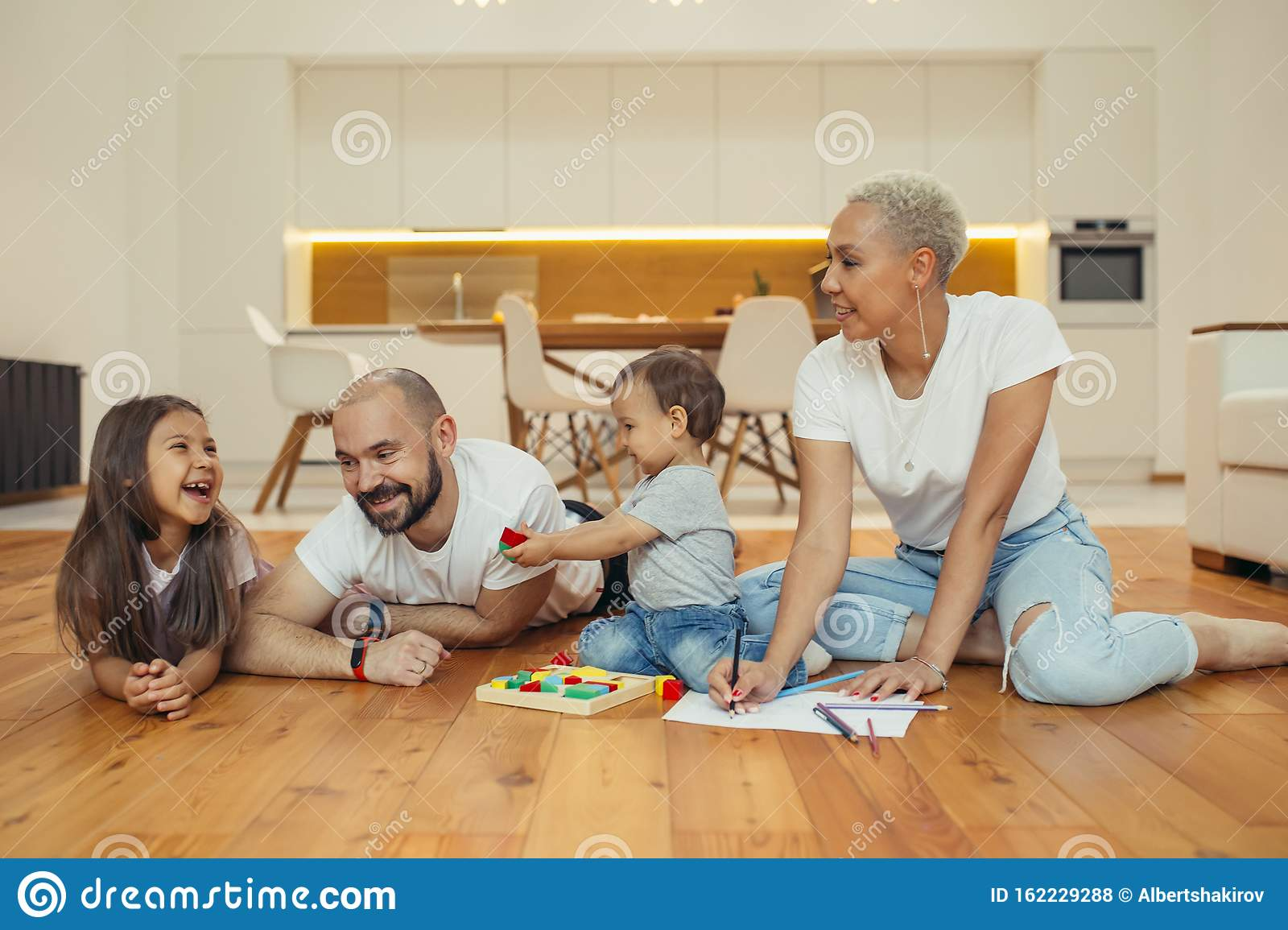 Caucasian Family Parents With Children Playing And Laughing On