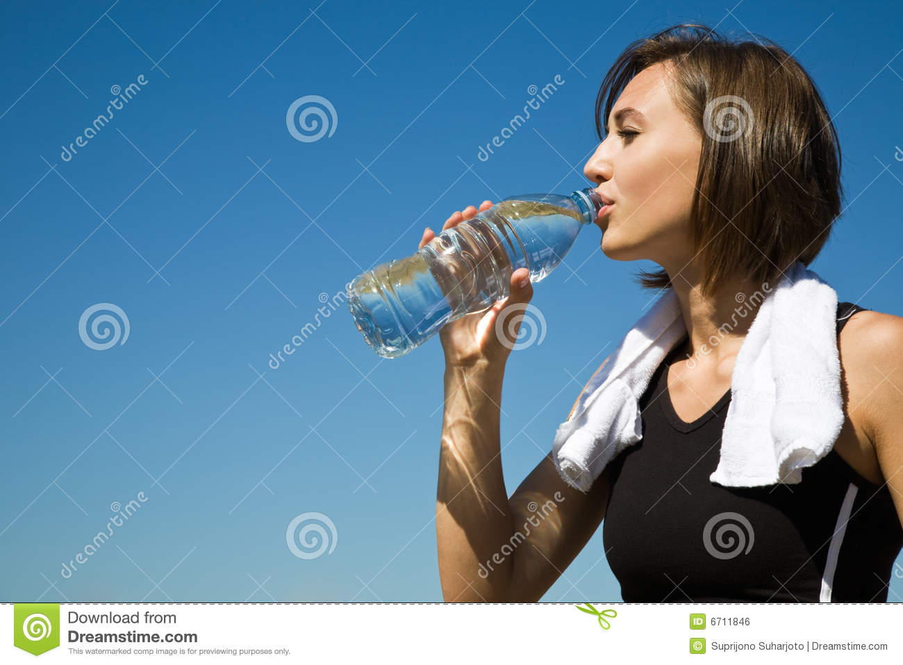 Caucasian girl drinking water after exercise