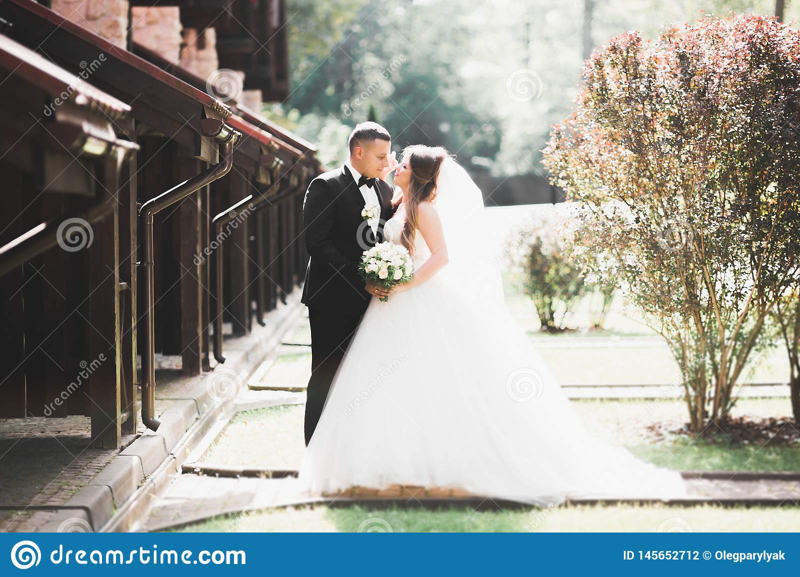 Caucasian happy romantic young couple celebrating their marriage. Outdoor
