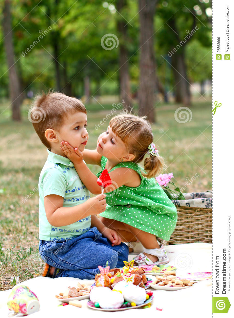 Caucasian Little Boy And Girl Eating Sweets Royalty Free