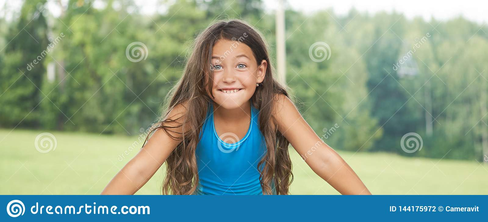 Caucasian little girl with long hair in swimsuit. Happy child