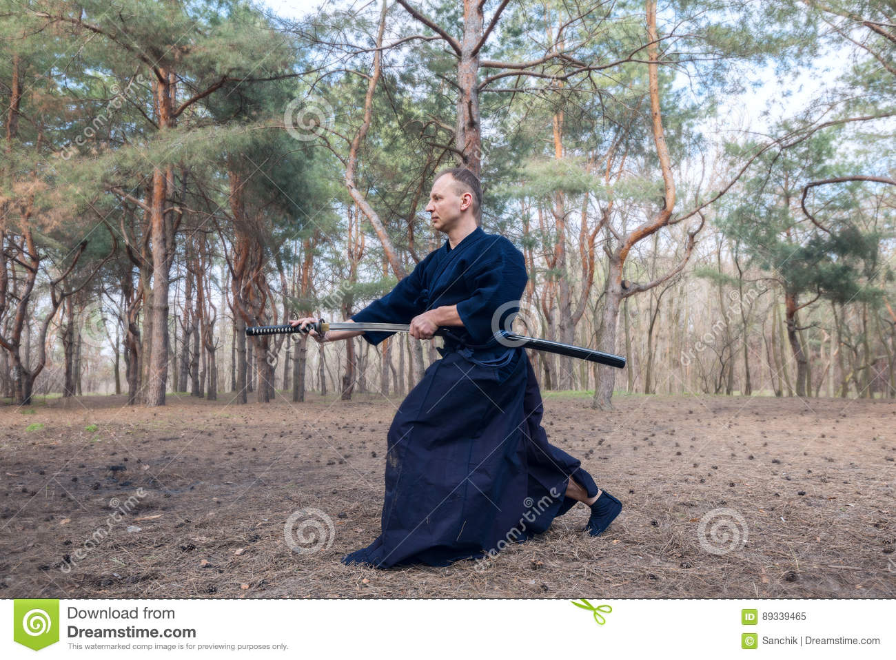 Caucasian Man With A Japanese Sword, A Katana Practicing