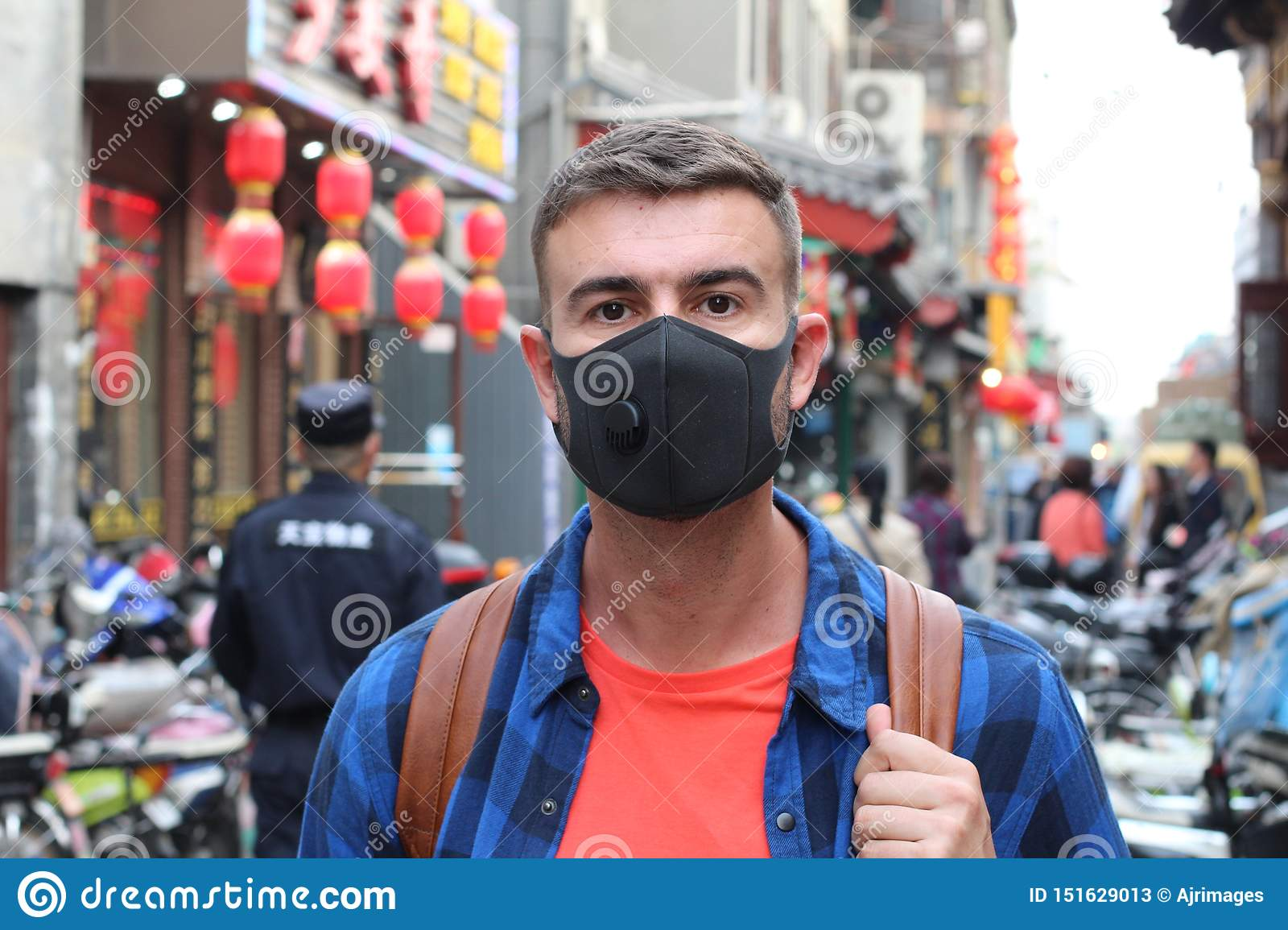 Caucasian man wearing pollution mask in Asia