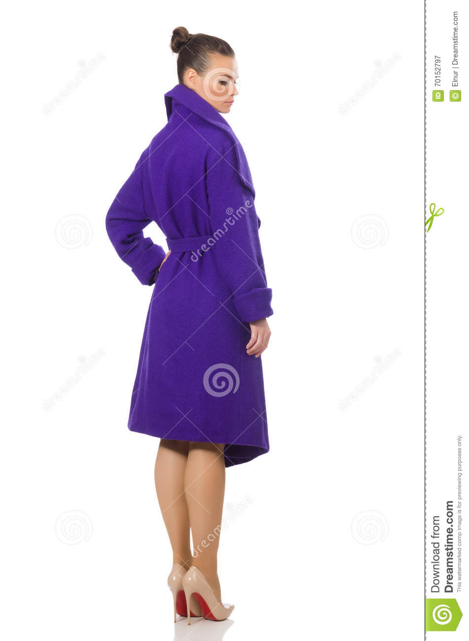 The caucasian model in purple coat isolated on white