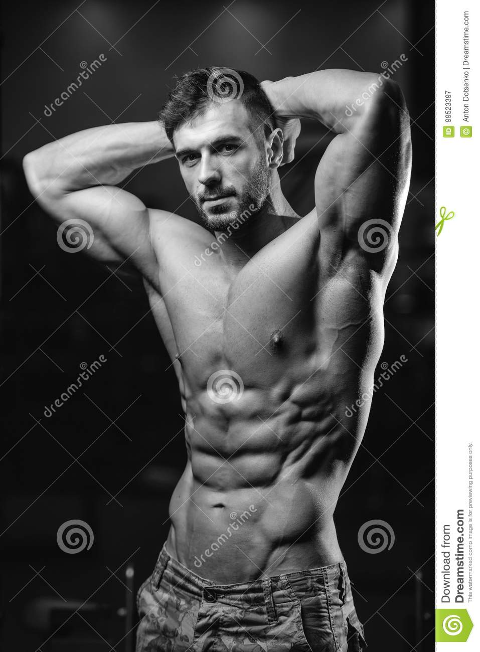 Caucasian fitness model in gym close up abs