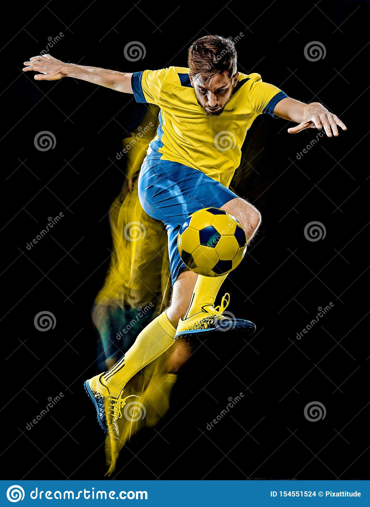 Caucasian soccer player man black background light painting