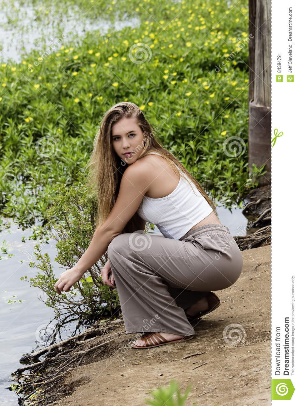 Teenage Caucasian Girl15 Years Old Sitting Outdoors: Caucasian Teen Girl Squatting On River Bank Stock Image