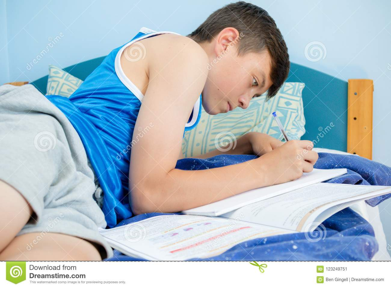 Teen boy in bed late, than