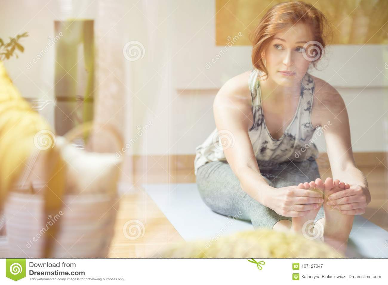 Woman exercising in bright room