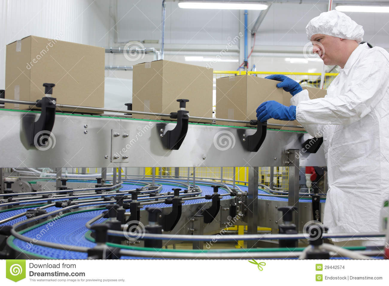 worker in white apron at packing line