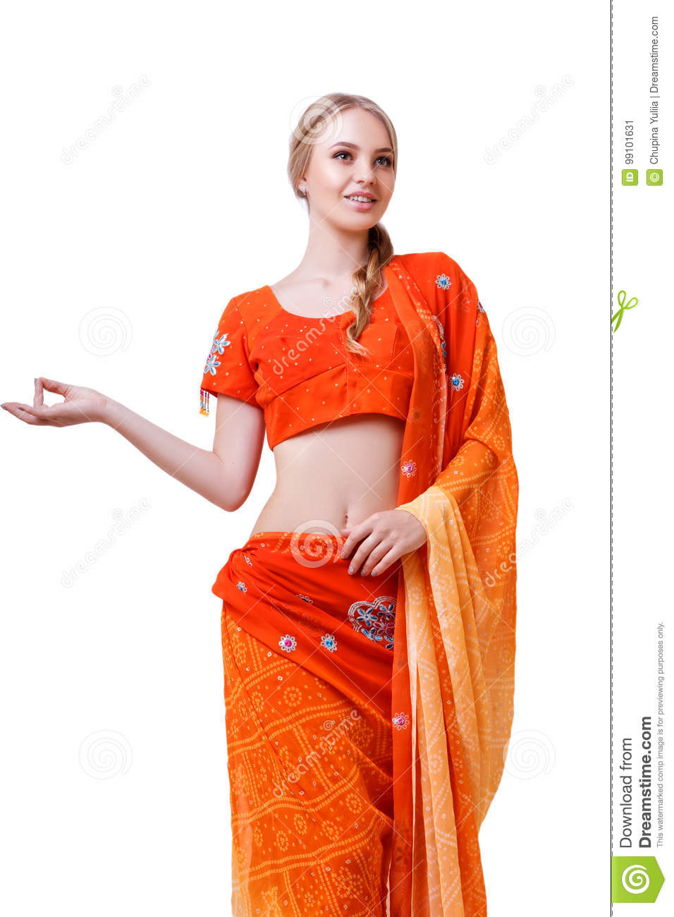 95e593d6b2 Caucasian blonde smiling girl in red indian national dress sari in studio  on white background isolated