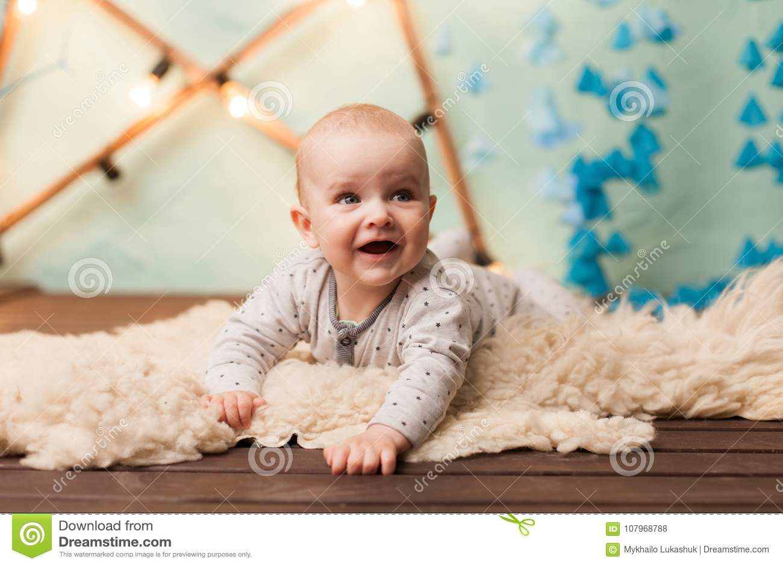 Caucasuian adorable baby on floor inside the house
