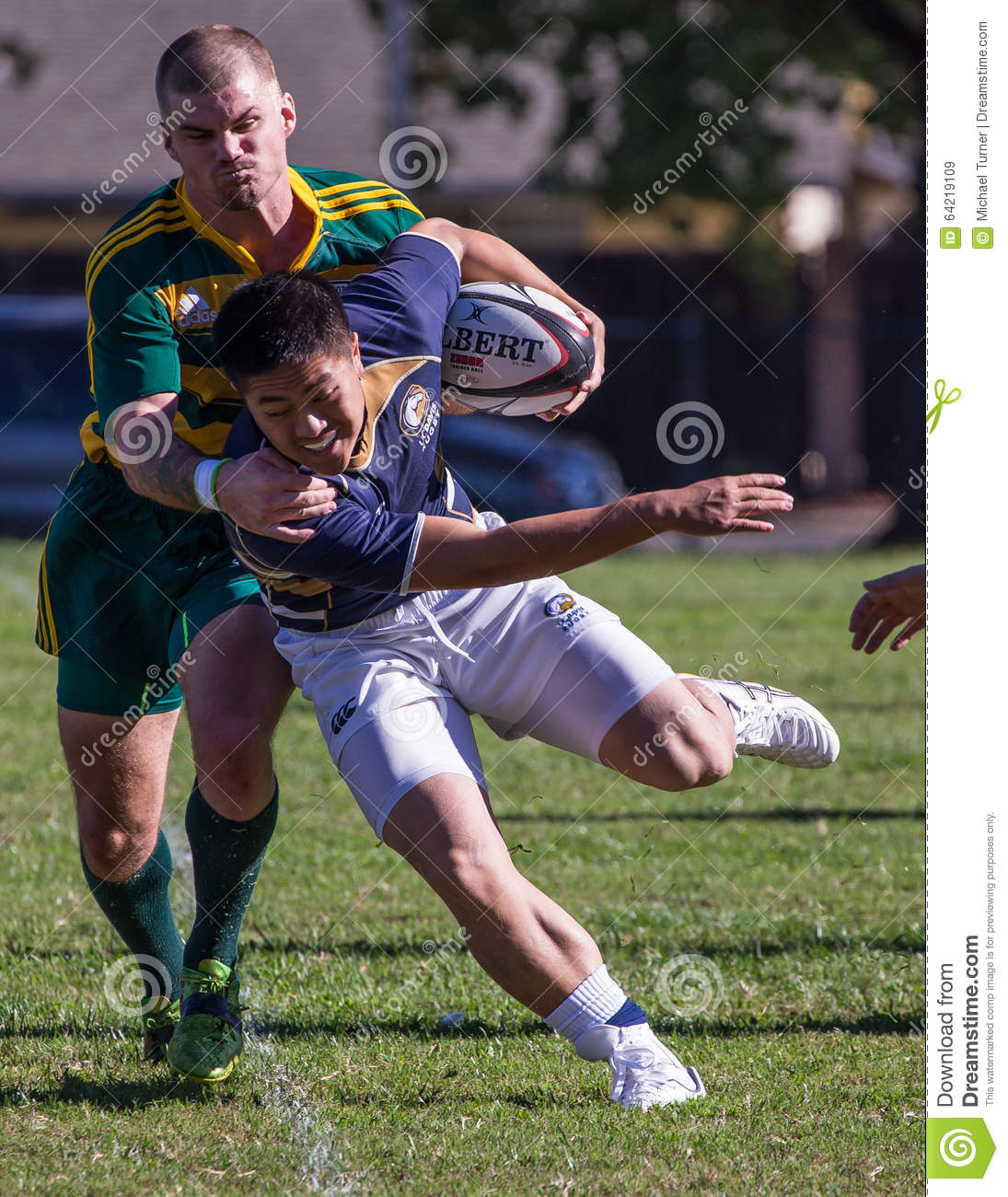 Green Rugby Player: Caught From Behind Editorial Stock Image