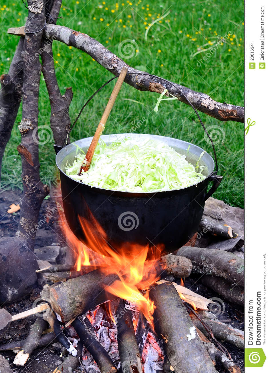 Cauldron with cabbage on outdoor camping stock image for Cuisine outdoor
