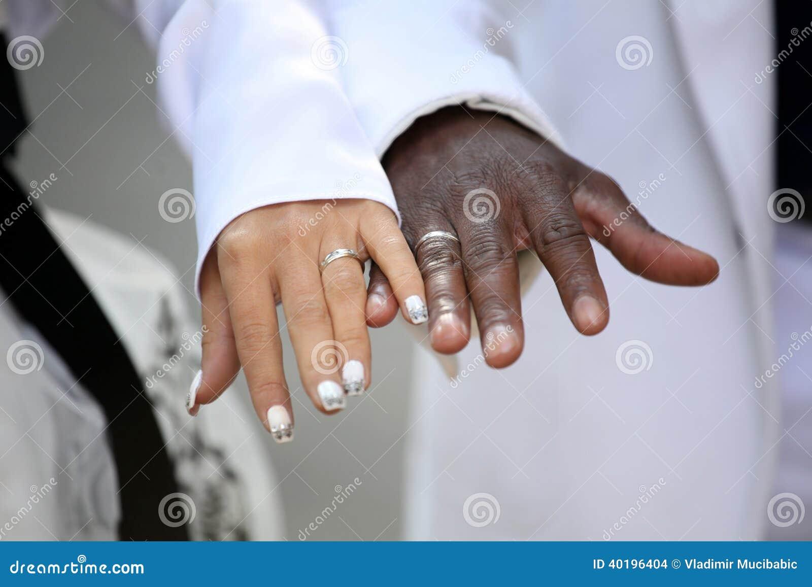 Wedding Rings On Black Hands