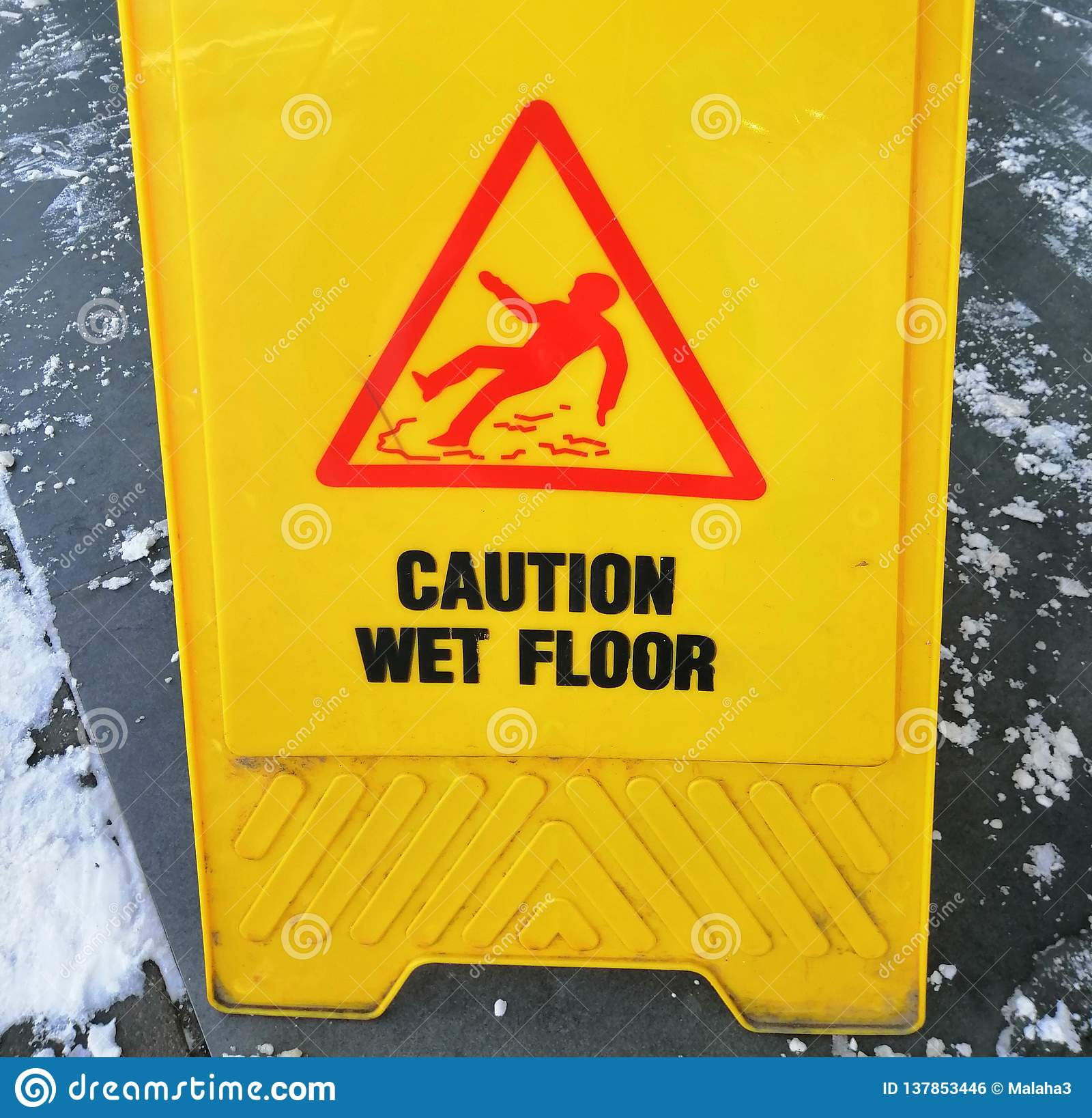 Caution ice - a sign for pedestrians in the winter