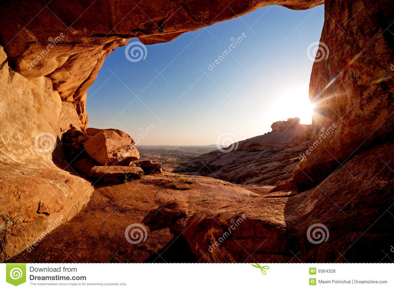 Cave and sunset in the desert mountains