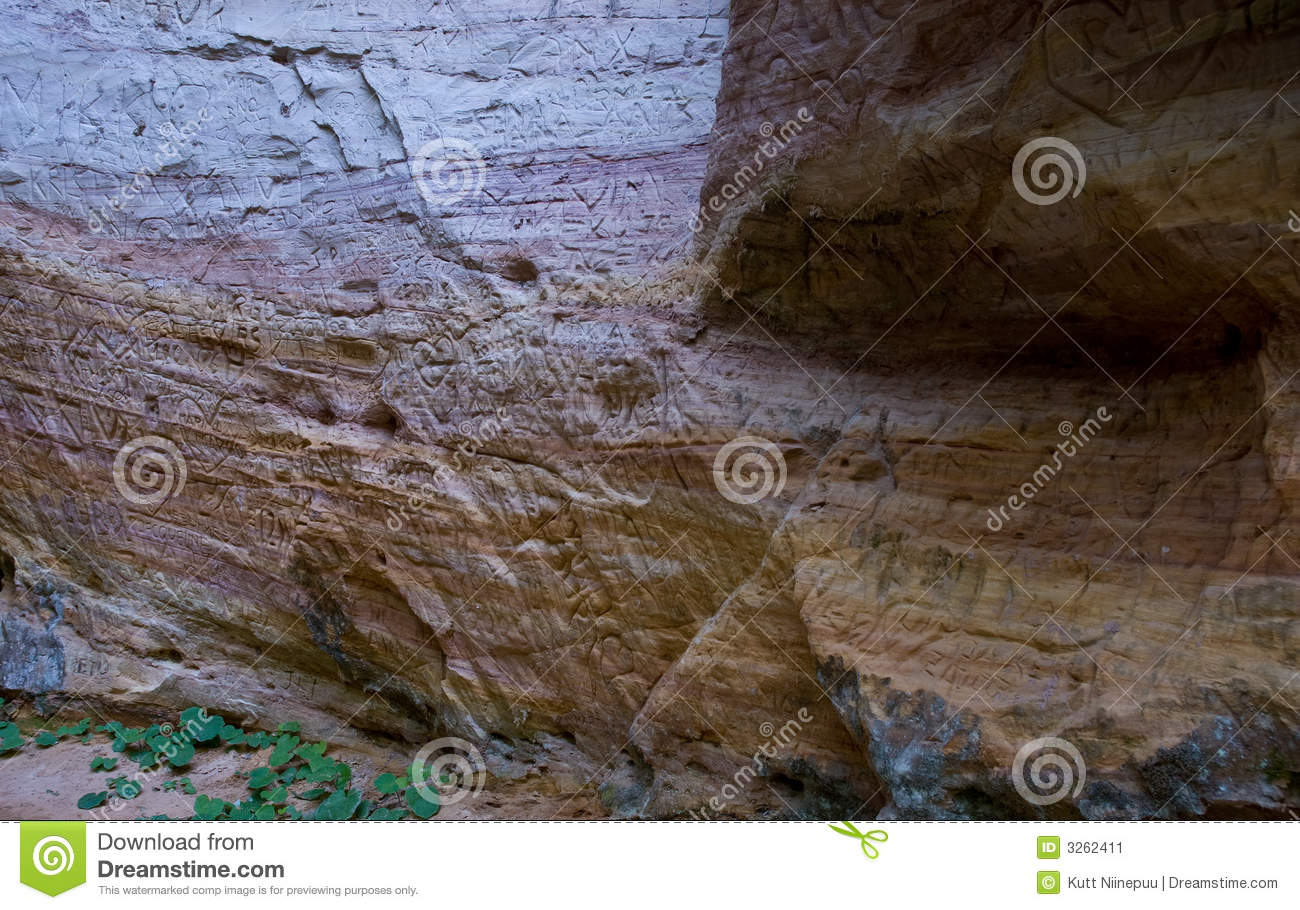 Cave wall with carvings stock image