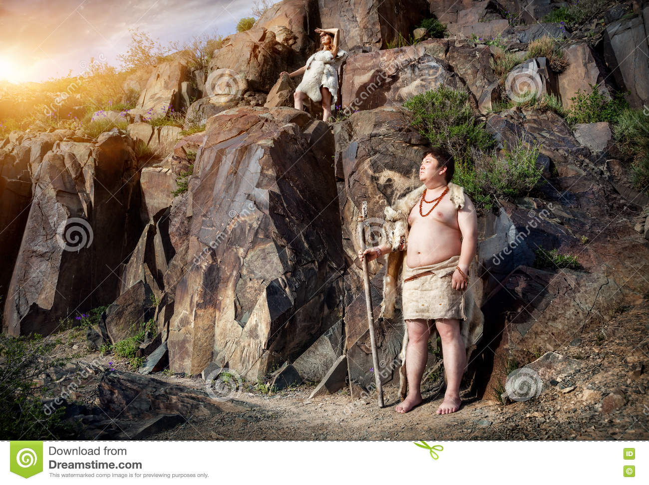 Man Cave For Women : Caveman and woman in animal skin stock image of