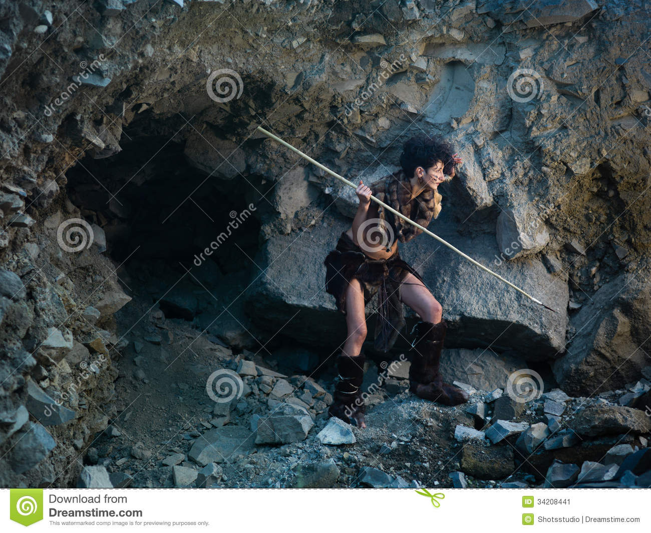 Caveman Spear : Cavewoman hunting with spear stock image