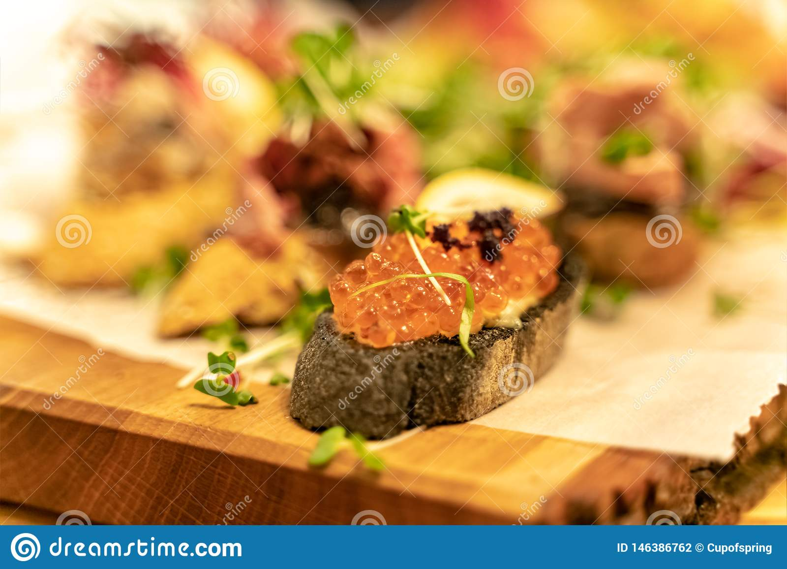 Caviar antipasti wine snacks set with Shallow depth of focus over dark grunge background