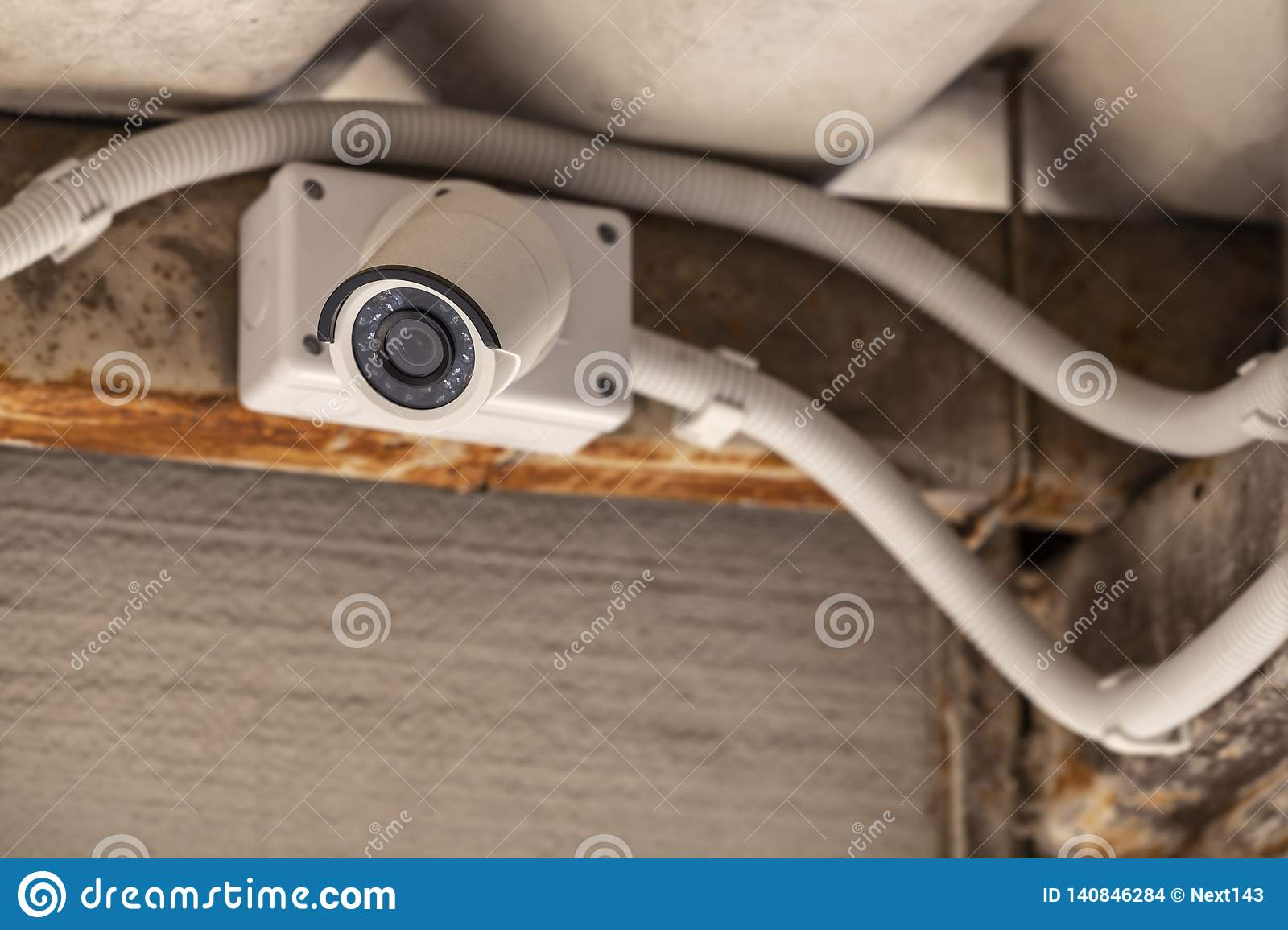 CCTV mounted on ceiling under the roof