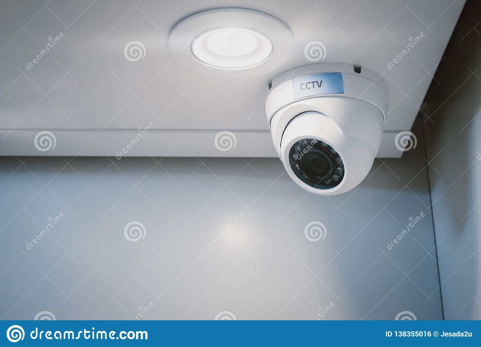 CCTV security camera on wall in the home office for surveillance monitoring home guard system.