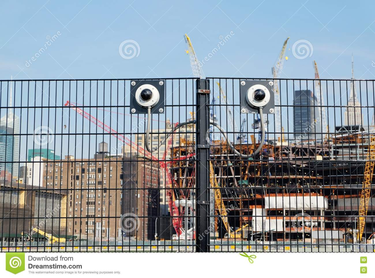 Cctv security cameras on a fence stock photo image