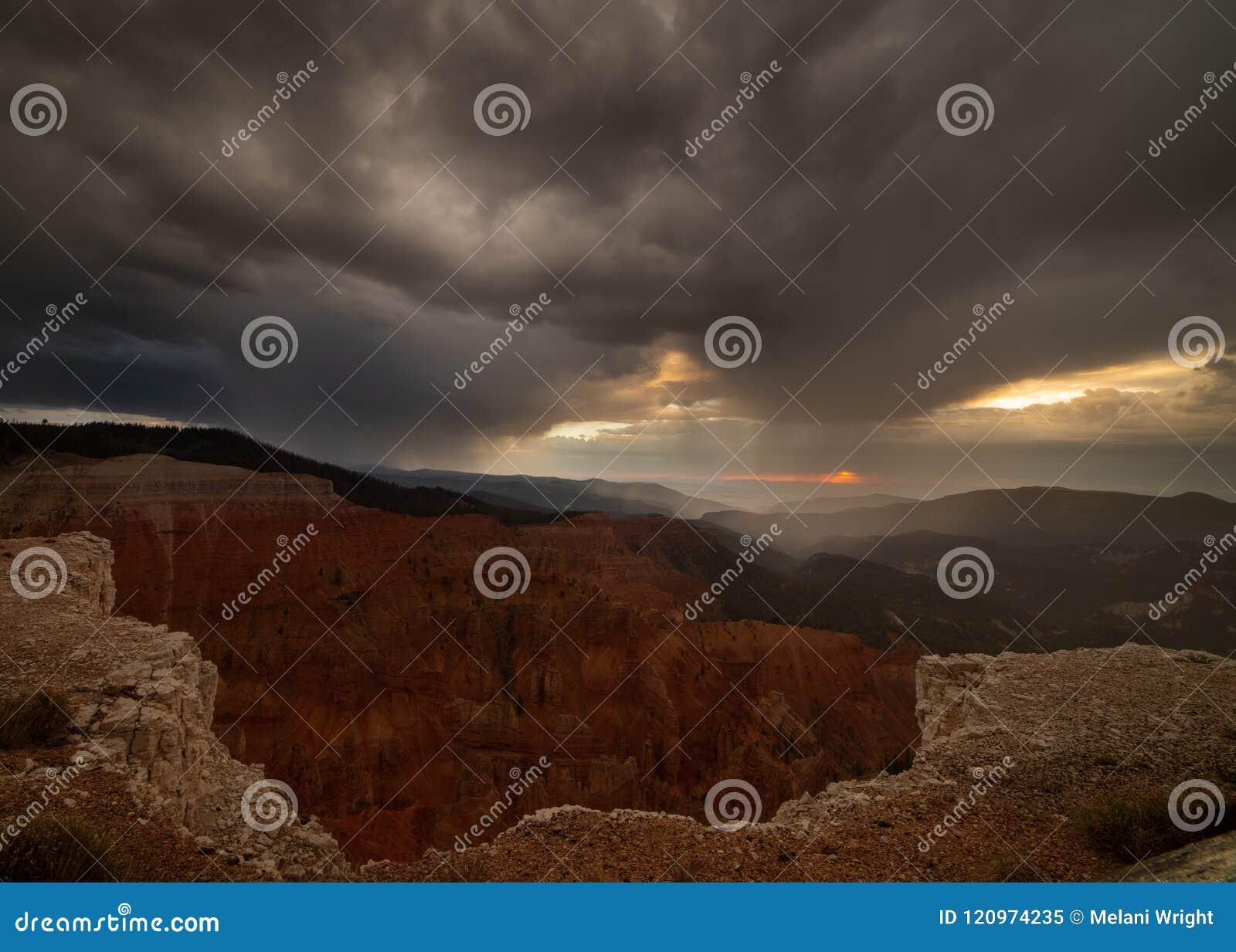 Cedar breaks amphitheater under dark stormy skies at sunset