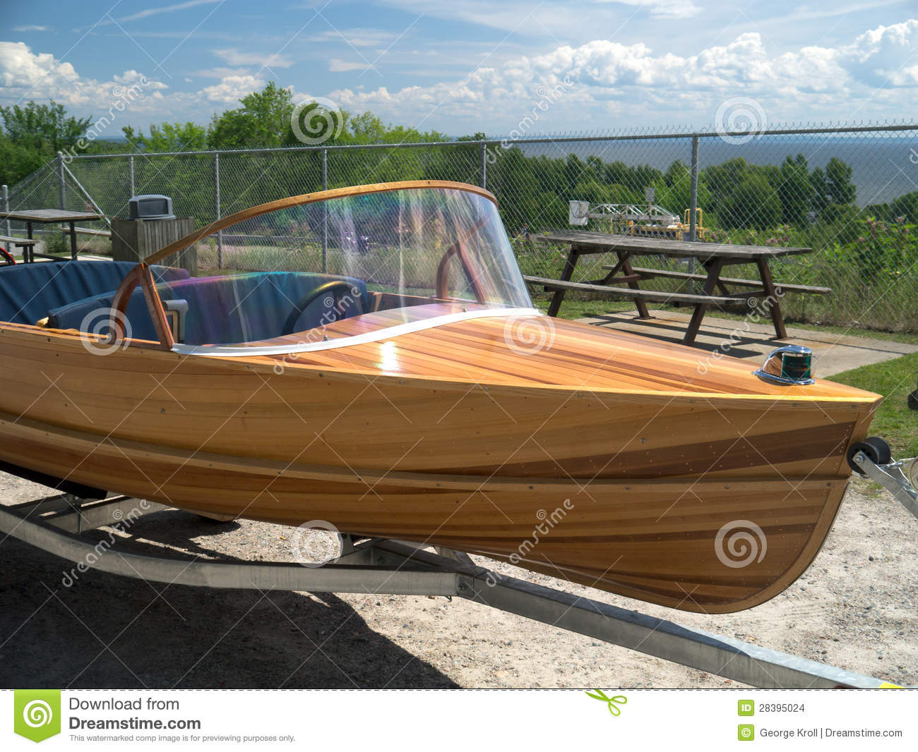 Stock Images: Cedar Strip Wood Speed Boat on Trailer. Image: 28395024