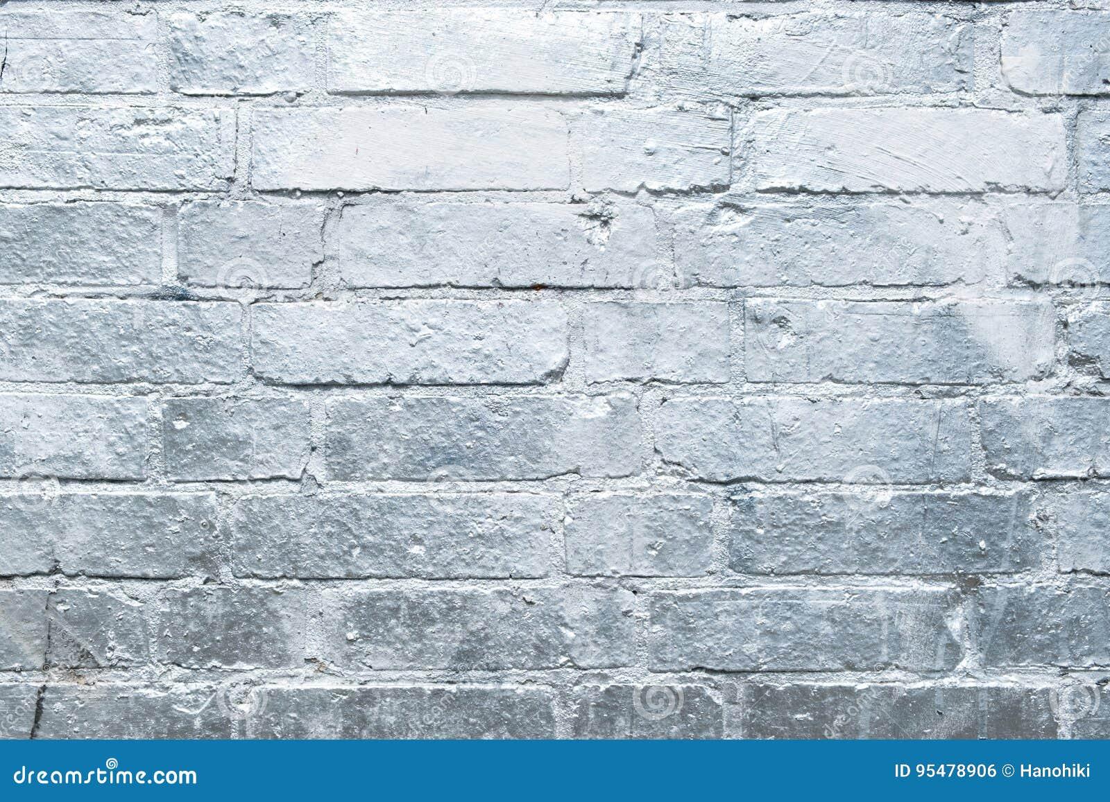 Ceglana kamienna ściana malował w srebrze, graffiti tło
